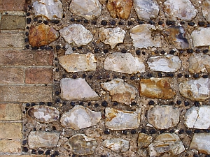 dressed flints, local bricks, lime mortar and carstone galleting (© Tim Holt-Wilson)
